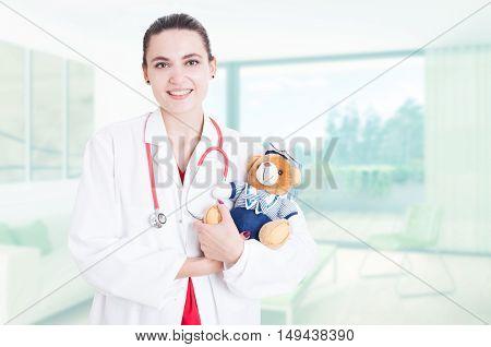 Professional Woman Medic Holding Teddy Bear