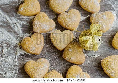 Heart shaped cookies covered with sugar powder