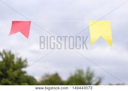 Red and yellow ribbon on a white robe at a festival