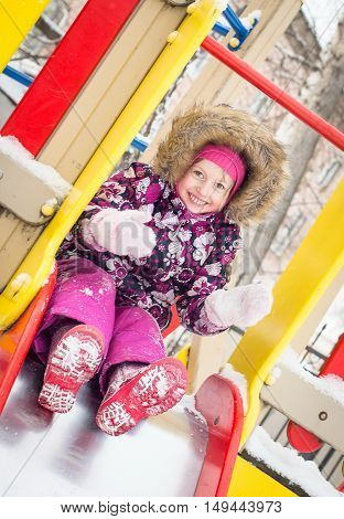 Closeup Portrait Of Happy Laughing Children In Winter Clothes Playing On The Colorful Playground, Ro