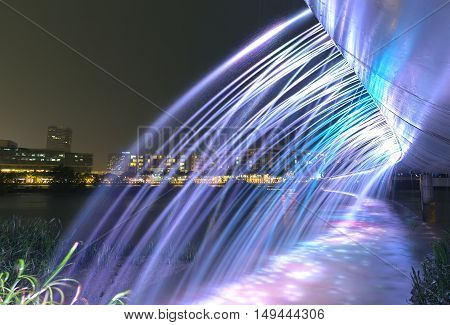 Ho Chi Minh City, Vietnam - September 17th, 2016: Beautiful bridge with water Fountain illuminated by colorful flow adorn the shimmering beauty at night urban in Ho Chi Minh City, Vietnam