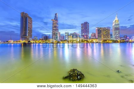 Ho Chi Minh City, Vietnam - September 23rd, 2016: Beauty skyscrapers along river light smooth down urban development in Ho Chi Minh City, Vietnam