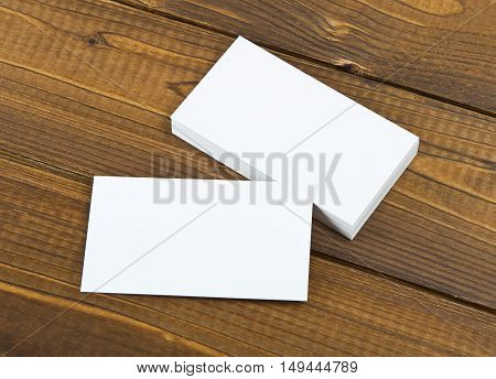 Blank business cards on a wooden background. Identity design corporate templates company style