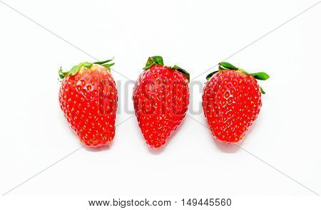 Three fresh strawberry isolated on white background.