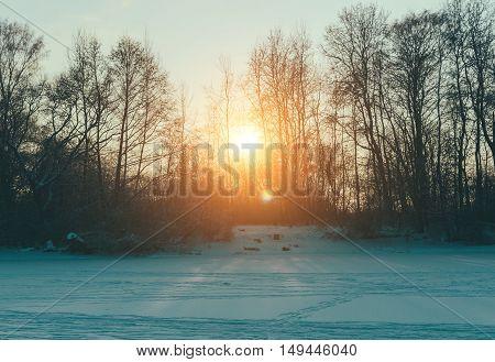 Landscape on the frozen winter lake in juniary