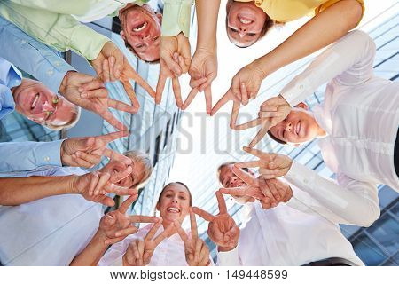 Happy business people team forming a star with their hands