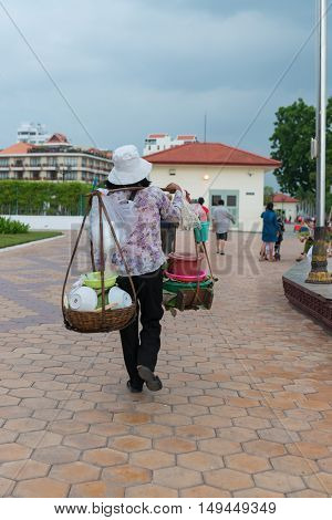 Local Vendor Carrying Street Foods On A Shoulder Mounted Rack.