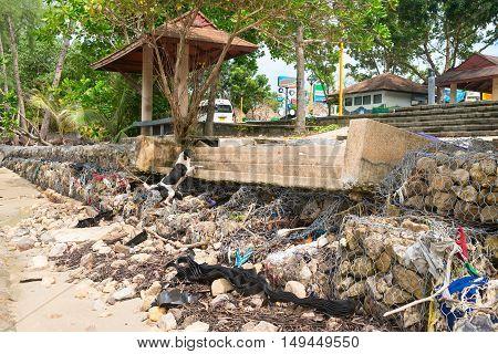 Cement Erosion Barrackade And Steps On A Beach