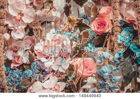 Vintage style faded natural flowers background.