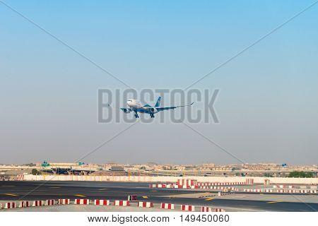 Oman Air Airplane Lands In International Dubai Airport