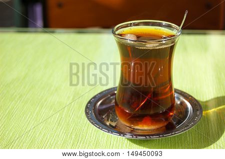 Glass cup of Turkish tea in traditional shapes. Tea in Turkey.