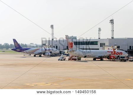 Passenger Aircraft Docked At The Main Terminal Of Don Mueang International Airport.