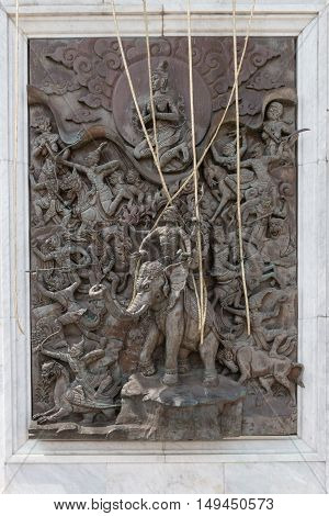 Beautiful And Intricate Bas Relief Sculpture Near The Entrance To Wat Traimit In Bangkok.