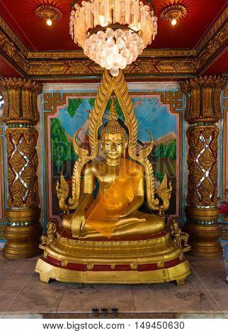 Golden Statue Of The Buddha Inside Li Thi Miew Shrine