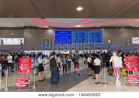 Passengers Strolling Between Ticketing Counters At Don Mueang International Airport In Bangkok.