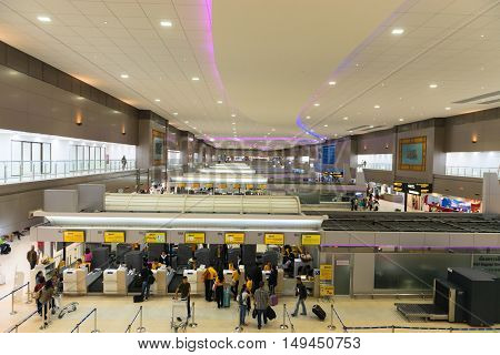 Passengers Checking Luggage At The Ticketing Counters Of Don Mueang International Airport In Bangkok