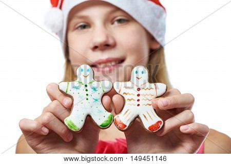 Girl With Christmas Gingerbread Man Cookies In Hands