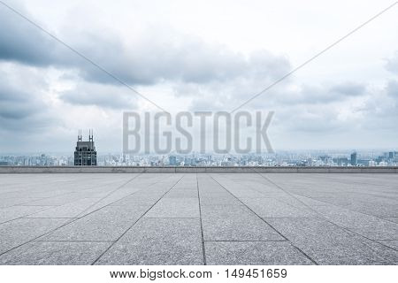 cityscape and skyline of shanghai from empty brick floor