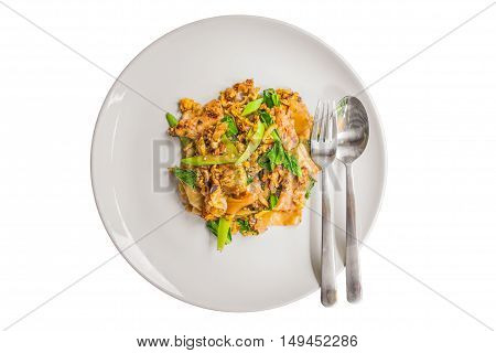 Stir fried flat noodle and pork with dark soy sauce in plate isolated on white background.