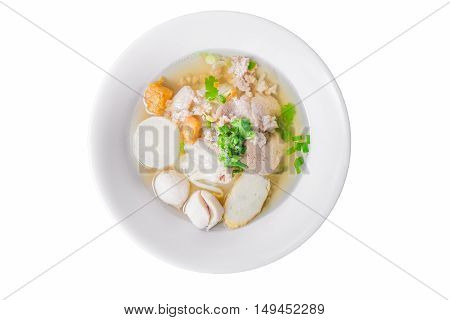 Noodles of Thai style clear soup in traditional ceramic bowl isolated on white background. view from above