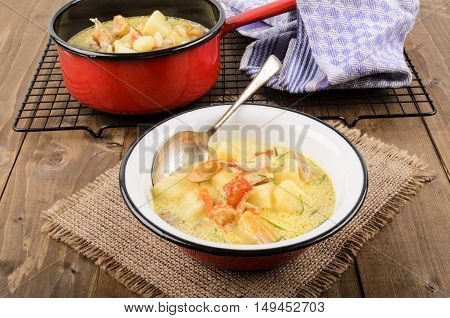 cullen skink typical scottish food with smoked haddock in a pot and bowl on jute