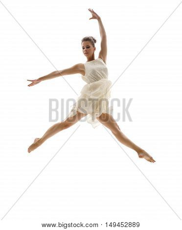 Beautiful ballerina posing in graceful leap. Isolated on white background