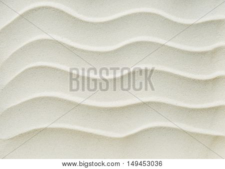 Beautiful white background of fine clean sand with waves
