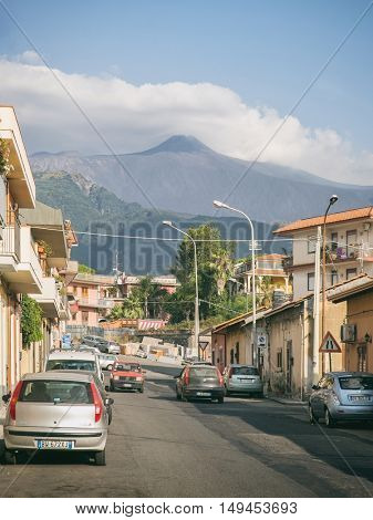 San Giovanmi Galermo, Sicily, Italy - JUL 25, 2016: Distant view the volcano Etna from inhabited areas on its feet