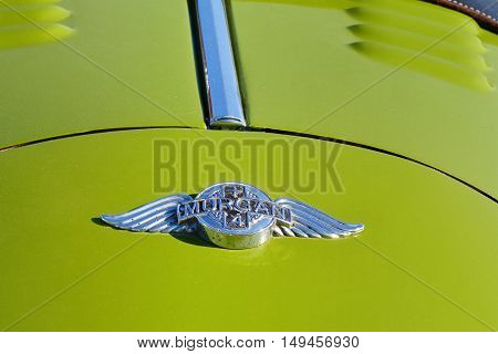CLUJ-NAPOCA ROMANIA - SEPTEMBER 24 2016: Emblem of Morgan Plus 4 roadster classic car made by the Morgan Motor Company from 1950 to 1969