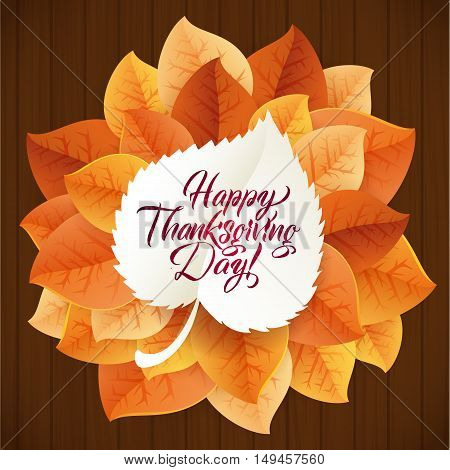 Happy Thanksgiving Day circular ornament made of leaves on wood background. Happy Thanksgiving Day Greeting Card Poster. Thanksgiving Day card template. Happy Thanksgiving banner, flyer.
