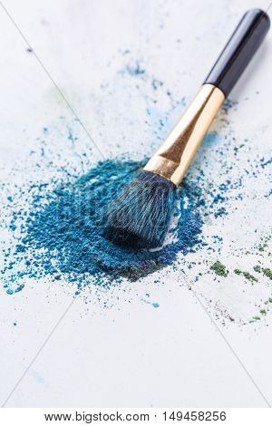 Brush for make-up ,crumbly shadows on white background