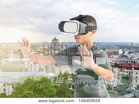 Double exposure. Afro-Amrican boy wearing virtual reality glasses and city background. Modern technology concept.