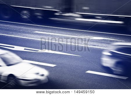 Three cars going along the crossroads, blue tinted