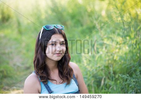 Portrait of a cute teen girl in the summer