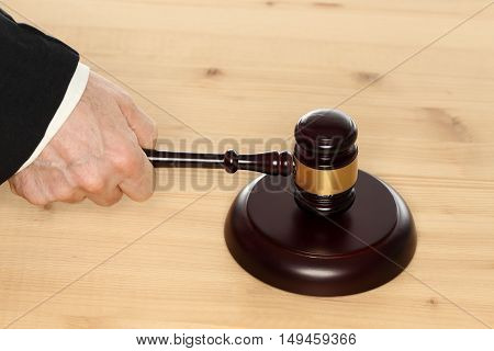 brown gavel in hand of a judge