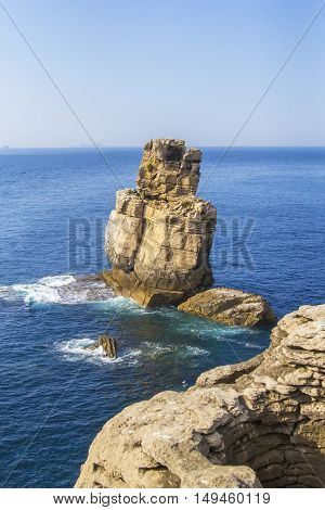 background view of liffs in the Atlantic  ocean off the coast of Penichee in the peninsulae Cabo Carvoeiro, Portugal