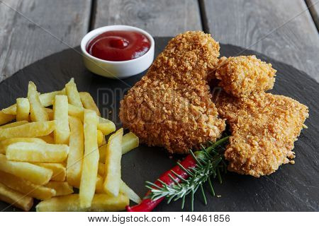 Breaded crispy chicken wing fried french fries sauce