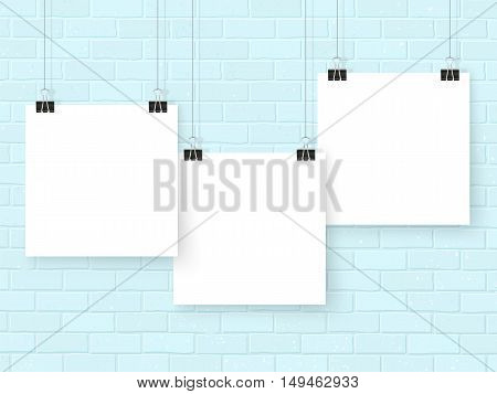 Posters template on grey brick wall. Realistic wall gallery vector illustration. Set of white empty vector notes mockup for your illustrations drawings logos posters or quotes.
