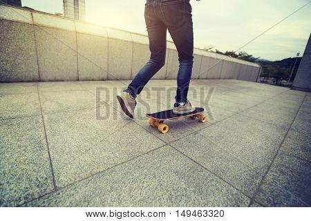 one young skateboarder legs skateboarding at city