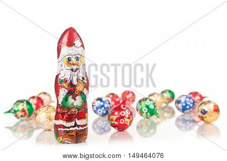 Closeup of Santa Claus chocolate figurine isolated on white background