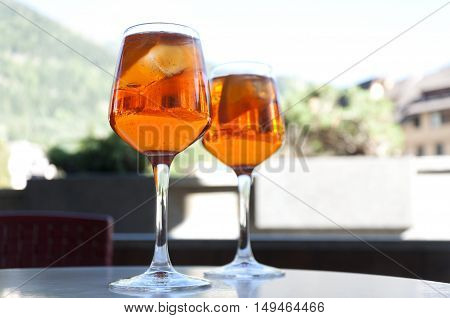 two glasses with a cocktail Aperol in a street cafe in Italy