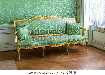 Vintage luxury Green sofa near window.