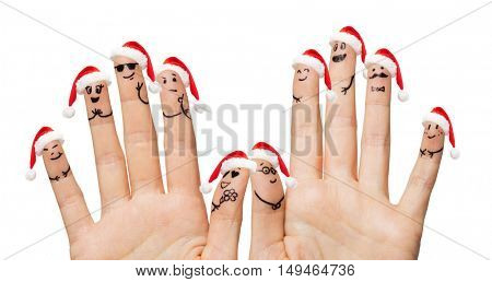 christmas, family, holidays, people and body parts concept - close up of two hands showing fingers with smiley faces