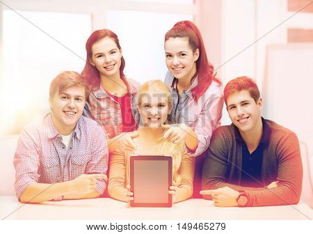 education, technology, advertisement and internet concept - group of smiling students with blank black tablet pc screen