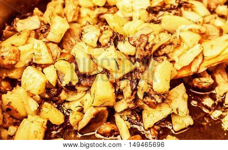 Fresh roasted potatoes with mushroom in kitchen bowl