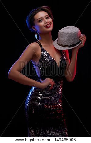 Beautiful Vietnamese young woman with a hat looking at camera