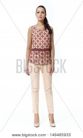 woman with straight hair style in summer print blouse and trousers high heel shoes full body length isolated on white