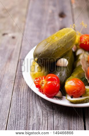 Cucumbers And Tomatoes In A Plate