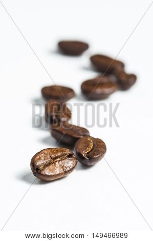 Coffee beans on white background. Vertical view.