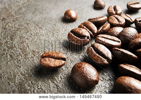 Coffee beans on a grunge background close up